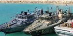 This picture released by the Iranian Revolutionary Guards on Wednesday, Jan. 13, 2016, shows detained American Navy sailors' boats in custody of the guards in the Persian Gulf Iran. Less than a day after 10 U.S. Navy sailors were detained in Iran when their boats drifted into Iranian waters, they and their vessels were back safely Wednesday with the American fleet. (Sepahnews via AP)
