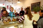 FILE - In this April 20, 2015, file photo, Democratic presidential candidate Hillary Clinton waves to employees at Kristin's Bakery during her first New Hampshire campaign stop in Keene, N.H. AP Photo/Jim Cole, File)