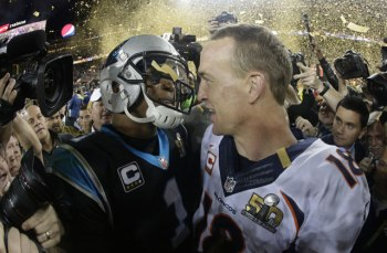 Denver Bronco'' Peyton Manning, right, greets Carolina Panthers' Cam Newton (1) after the NFL Super Bowl 50 football game Sunday, Feb. 7, 2016, in Santa Clara, Calif. The Broncos won 24-10. (AP Photo/Julio Cortez)