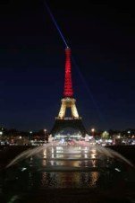 The Eiffel Tower is illuminated with the Belgium national colors black, yellow and red in honor of the victims of the today's attacks at the airport and the metro station in Brussels, in Paris, Tuesday, March 22, 2016. (AP Photo/Thibault Camus)
