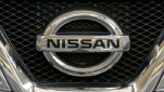 This photo taken on Feb. 14, 2013 shows the Nissan logo on the grill of a 2013 Nissan SL Rogue on display at the  2013 Pittsburgh Auto Show in Pittsburgh. (AP Photo/Gene J. Puskar)