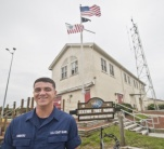 Coast Guard Station Fort Macon Fireman James D. Sanders, Jr., stands outside the station, Friday, May 20, 2016.  Sanders witnessed a pier collapse in Beaufort while he was off duty May 11, 2016, and immediately took action to save the lives of several women who fell in the water.  (U.S. Coast Guard photo by Petty Officer 2nd Class Nate Littlejohn)