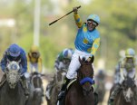 Victor Espinoza rides American Pharoah to victory in the 141st running of the Kentucky Derby horse race at Churchill Downs Saturday, May 2, 2015, in Louisville, Ky. (AP Photo/Darron Cummings)