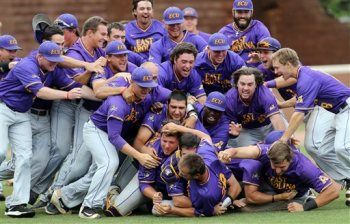 East Carolina players celebrate an 8-4 victory over William & Mary to win the NCAA Charlottesville Regional championship baseball game, Sunday, June 5, 2016 in Charlottesville, Va. (Andrew Shurtleff/The Daily Progress via AP)