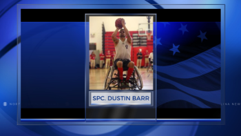 U.S. Army veteran Spc. Dustin Barr, Jamesville, N.C., lines up for a free throw during a wheelchair basketball game at the 2015 Department of Defense Warrior Games at Marine Corps Base Quantico, Va., June 20, 2015. (Photo: Department of Defense Warrior Games)