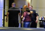 Law enforcement officials escort a couple in through the emergency room entrance at Baylor University Medical Center, Friday, July 8, 2016, in Dallas. Snipers opened fire on police officers in the heart of Dallas on Thursday night, killing some of the officers. (AP Photo/Tony Gutierrez)
