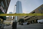 Police tape marks off the area where a shooting took place in downtown Dallas, Friday, July 8, 2016. Snipers opened fire on police officers in the heart of Dallas during protests over two recent fatal police shootings of black men. (AP Photo/LM Otero)