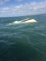 Coast Guard pulls two men from Bogue Inlet after their boat capsizes.