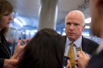 In this Oct. 20, 2015, photo, Senate Armed Service Committee Chairman Sen. John McCain, R-Ariz., talks to reporters near the subway on Capitol Hill in Washington. (AP Photo/Carolyn Kaster)