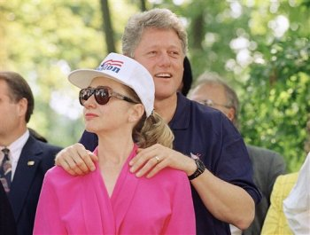 FILE - In this July 21, 1992 file photo, then-Democratic presidential nominee Bill Clinton stands with his wife, Hillary Clinton, during a campaign stop at General Butler State Park in Carrollton, Kentucky. (AP file)