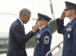 In this June 16, 2016 file photo, President Barack Obama returns a salute as he boards Air Force One at Andrews Air Force Base, Maryland. Obama is expected to tour flood-damaged areas in Louisiana and speak with survivors Tuesday. (AP file)