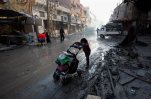 This 2013 file photo shows Syrian civilians looking for shelter as the country remains on edge in civil war. Democratic presidential candidate Hillary Clinton believes stronger action can be taken to end Syria's war, eliminate ISIS and prevent another power vacuum in the Middle East. (AP file)