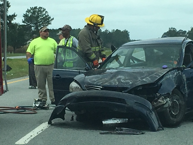 2 injured after car flips, shuts down traffic on I-264