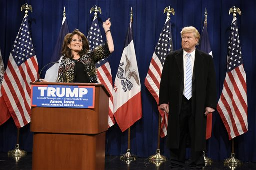 "This Saturday, Jan. 23, 2016 image provided by NBC shows Tina Fey, left, as Sarah Palin and Darrell Hammond as Donald Trump during the ""Palin Endorsement Cold Open"" sketch on ""Saturday Night Live."" The sketch kicked off the cold open to ""SNL"" on Saturday, with Fey and Hammond skewering the former Alaska governor's endorsement speech in Iowa on Tuesday. (Dana Edelson/NBC via AP)"