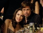 Angelina Jolie, left, and Brad Pitt sit together before the start of the 14th Annual Screen Actors Guild Awards on Sunday, Jan. 27, 2008, in Los Angeles.  (AP Photo/Kevork Djansezian)