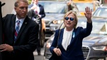 "Democratic presidential candidate Hillary Clinton walks from her daughter's apartment building Sunday, Sept. 11, 2016, in New York. Clinton unexpectedly left Sunday's 9/11 anniversary ceremony in New York after feeling ""overheated,"" according to her campaign. She later revealed she was diagnosed with pneumonia on Friday. (Craig Ruttle/AP)"