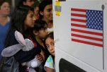 FILE - In this July 7, 2015 file photo, immigrants from El Salvador and Guatemala who entered the country illegally board a bus after they were released from a family detention center in San Antonio. (AP Photo/Eric Gay, File)