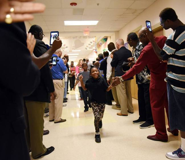 165 men show up to Lenoir Co. elementary school to support students