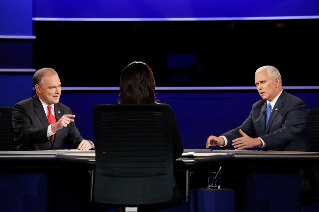 Republican vice-presidential nominee Gov. Mike Pence, right, and Democratic vice-presidential nominee Sen. Tim Kaine discuss a question during the vice-presidential debate at Longwood University in Farmville, Va., Tuesday, Oct. 4, 2016. (AP Photo/David Goldman)