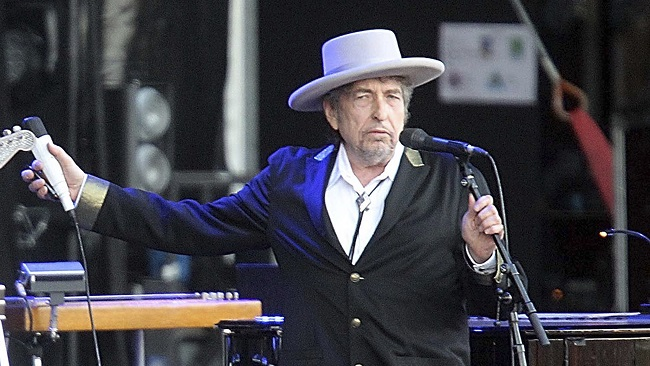 """This July 22, 2012, file photo shows U.S. singer-songwriter Bob Dylan performing onstage at """"Les Vieilles Charrues"""" Festival in Carhaix, western France. Dylan won the 2016 Nobel Prize in literature, announced Thursday, Oct. 13, 2016. (AP file)"""