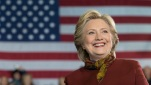 Democratic presidential candidate Hillary Clinton smiles as Democratic vice presidential candidate Sen. Tim Kaine, D-Va., speaks during a campaign event at the Taylor Allderdice High School, Saturday, Oct. 22, 2016, in Pittsburgh, Pa. (AP Photo/Mary Altaffer)
