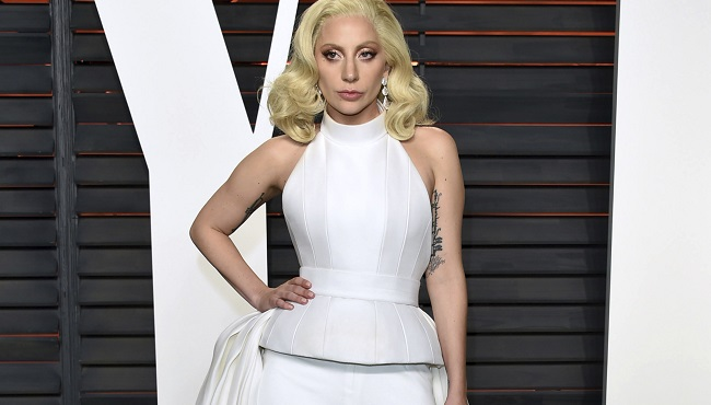 "FILE - In this Feb. 28, 2016 file photo, Lady Gaga arrives at the Vanity Fair Oscar Party in Beverly Hills, Calif. Lady Gaga is choosing the intimacy of dive bars over arenas to showcase songs from her new album, ""Joanne."" She'll appear at a handful of bars beginning this week as a nod to the album's ""raw Americana"" vibe and where she got her start, Gaga and tour partner Bud Light announced Sunday, Oct. 2, 2016. (Photo by Evan Agostini/Invision/AP, File)"