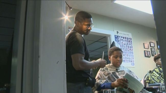 YPSILANTI, M.I. (WNCT)  A barber in Michigan is teaching kids the ...