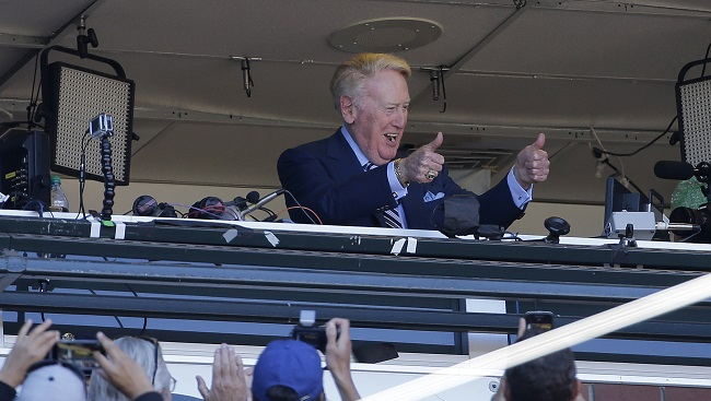 Los Angeles Dodgers announcer Vin Scully gestures to fans during the seventh-inning stretch of a baseball game between the San Francisco Giants and the Dodgers in San Francisco on Sunday, Oct. 2, 2016. After 67 years calling games for the Dodgers, Scully, 88, is set to retire. (Jeff Chiu/AP)