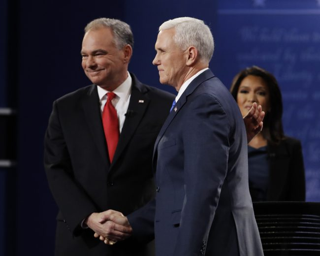 Moderator Elaine Quijano of CBS News watches as Republican vice-presidential nominee Gov. Mike Pence, right, shakes hands with Democratic vice-presidential nominee Sen. Tim Kaine during the vice-presidential debate at Longwood University in Farmville, Va., Tuesday, Oct. 4, 2016. (AP Photo/Julio Cortez)