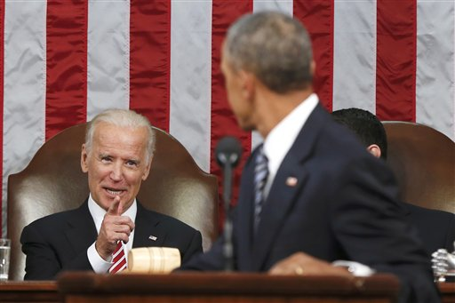 """FILE - In this Jan. 12, 2016 file-pool photo, Vice President Joe Biden points at President Barack Obama during the president's State of the Union address to a joint session of Congress on Capitol Hill in Washington. Harking back to America's triumphant race into space, the Obama administration is launching what it calls a """"moonshot"""" effort to cure cancer. Don't expect miracles in the president's last months, but there has been striking progress in recent years. (AP Photo/Evan Vucci, Pool, File)"""