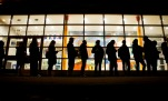 A line of voters stretches down the street as they wait for a polling site to open in New York, Tuesday, Nov. 8, 2016. (AP Photo/David Goldman)
