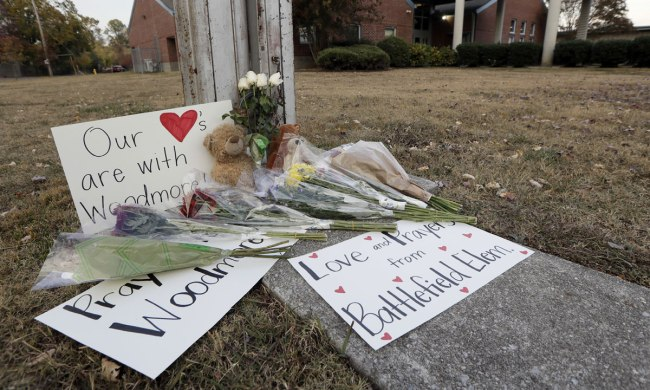 Flowers, signs and stuffed animals make up a makeshift memorial outside Woodmore Elementary School on Tuesday, Nov. 22, 2016, in Chattanooga, Tenn. (AP Photo/Mark Humphrey)