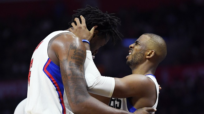Los Angeles Clippers center DeAndre Jordan, left, and guard Chris Paul react after banging heads as they were celebrating during the second half of an NBA basketball game against the Brooklyn Nets, Monday, Nov. 14, 2016, in Los Angeles. The Clippers won 127-95. (Mark J. Terrill/AP)