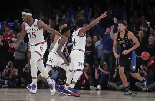 Kansas forward Carlton Bragg Jr. (15) and guard Devonte' Graham (4) react after guard Frank Mason III hit a shot to give Kansas the lead in the final seconds of an NCAA college basketball game against Duke, Tuesday, Nov. 15, 2016, in New York. Kansas won 77-75. (AP Photo/Julie Jacobson)