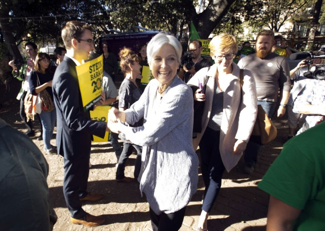 Green party presidential candidate Jill Stein, center, meets her supporters during a campaign stop at Humanist Hall in Oakland, Calif. on Thursday, Oct. 6, 2016. (AP Photo/D. Ross Cameron)