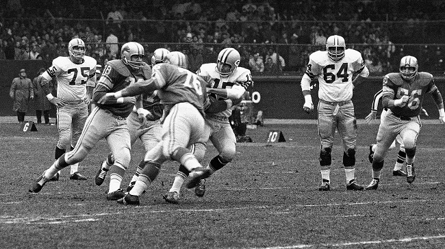 Green Bay Packers quarterback Bart Starr is tackled by Detroit Lions defenders during a 26-14 Lions victory on Thanksgiving Day, Nov. 23, 1962. The Detroit Lions have hosted an annual NFL game on Thanksgiving Day since 1934 only taking a break from 1939-1945 during World War II. (AP file)