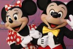"""Mickey Mouse, right, and Minnie Mouse pose on the press line at her """"Sweet Sixteen"""" birthday party at Disneyland in Anaheim, Calif. on Sunday, Oct. 5, 2008. (AP Photo/Dan Steinberg)"""