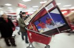 Shoppers take advantage of Black Friday sales in the early morning at a Target store Friday, Nov. 26, 2010 in Chicago.(AP Photo/Kiichiro Sato)