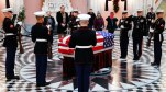 Marines stand guard at the casket of John Glenn, Friday, Dec. 16, 2016, in Columbus, Ohio. Glenn's home state and the nation began saying goodbye to the famed astronaut who died last week at the age of 95. (AP Photo/John Minchillo)