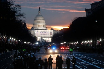 Security personnel gather on Pennsylvania Avenue before the presidential inauguration of President-elect Donald Trump, Friday, Jan. 20, 2017, in Washington. (AP Photo/John Minchillo)