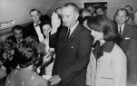 Lyndon B. Johnson, centers, takes the oath of office aboard Air Force One shortly after the assassination of President John F. Kennedy on Nov. 22, 1963. (Public Domain/The White House)