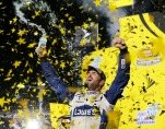 Jimmie Johnson celebrates his NASCAR Sprint Cup auto race and season title win Sunday, Nov. 20, 2016, in Homestead, Fla. (AP Photo/Terry Renna)