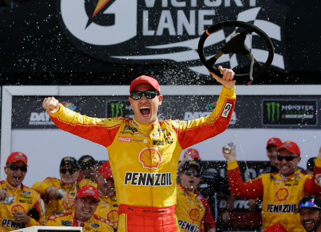 Joey Logano celebrates in Victory Lane after winning the NASCAR Clash auto race at Daytona International Speedway, Sunday, Feb. 19, 2017, in Daytona Beach, Fla. (AP Photo/John Raoux)