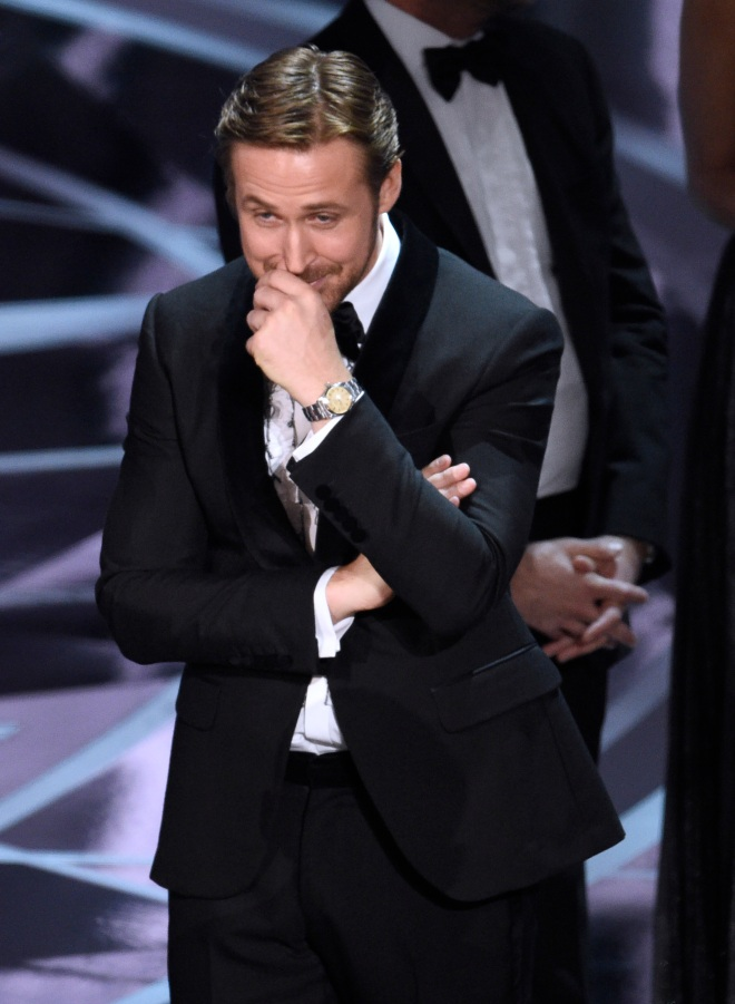 """Ryan Gosling reacts as the true winner of best picture is announced at the Oscars on Sunday, Feb. 26, 2017, at the Dolby Theatre in Los Angeles. It was originally announced that """"La La Land"""" won, but the winner was actually, """"Moonlight."""" (Photo by Chris Pizzello/Invision/AP)"""
