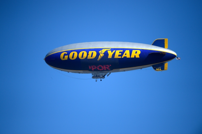 The Goodyear blimp flies overhead during the Daytona 500 NASCAR Sprint Cup series auto race at Daytona International Speedway, Sunday, Feb. 22, 2015, in Daytona Beach, Fla.(AP Photo/Phelan M. Ebenhack)