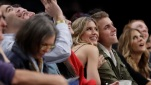 Genie Bouchard, left, poses for photographs with her blind date, John Goehrke, right, during the second half of an NBA basketball game between the Brooklyn Nets and the Milwaukee Bucks Wednesday, Feb. 15, 2017, in New York. After losing a Super Bowl bet on Twitter Bouchard agreed to go on a date with a random fan. (Frank Franklin II/AP)