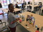 Charmaine Jones, Art Enables artist, creates original painting in Washington workshop.  (Photo: Art Enables)