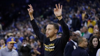 Golden State Warriors' Stephen Curry warms up before an NBA basketball game against the Brooklyn Nets on Saturday, Feb. 25, 2017, in Oakland, California. (Marcio Jose Sanchez/AP)