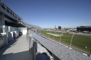 "In this Feb. 13, 2016 photo, a box suite is shown in the grandstands near the finish line of the at Daytona International Speedway in Daytona Beach, Fla. The project was such a massive undertaking that architects had to account for the curvature of the Earth. It also got its own nickname, ""Daytona Rising."" Now, the $400 million renovation to Daytona International Speedway is complete and ready for its big debut. (AP Photo/Phelan M. Ebenhack)"
