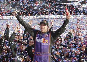 Denny Hamlin celebrates in Victory Lane after winning the NASCAR Daytona 500 Sprint Cup Series auto race at Daytona International Speedway in Daytona Beach, Fla., Sunday, Feb. 21, 2016. (AP Photo/Chuck Burton)